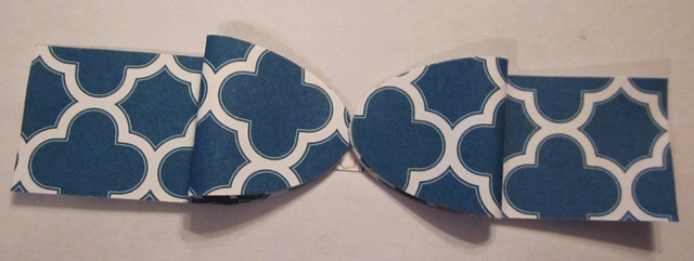 Oval punch faux bow 10