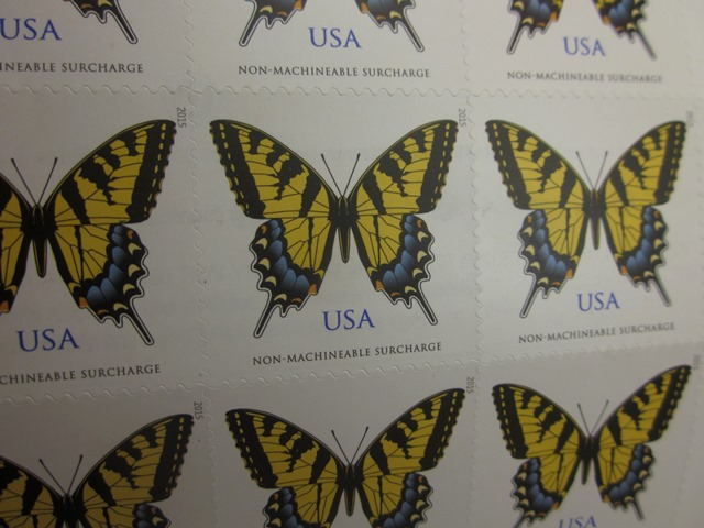 Non machineable postage stamp